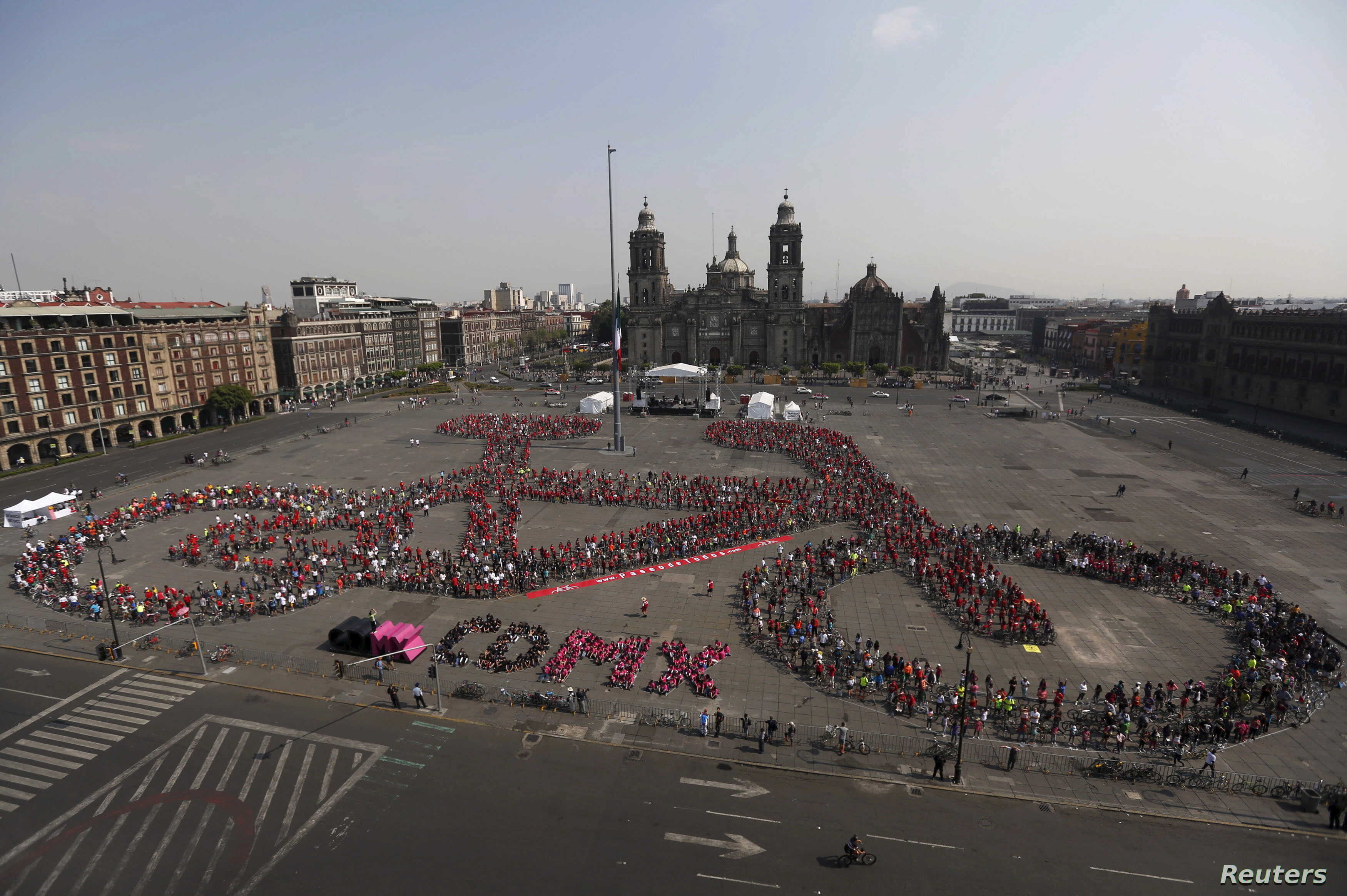 FILE - Cyclists gather to form a shape of a bicycle with the aim of promoting cycling as a mode of transport and to commemorate Bicycle Day, which is celebrated April 19 annually, at Zocalo square in Mexico City, Mexico, April 10, 2016.