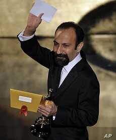"""Asghar Farhadi, of Iran, accepts the Oscar for best foreign language film for """"A Separation"""" during the 84th Academy Awards on Feb. 26, 2012, in the Hollywood section of Los Angeles."""