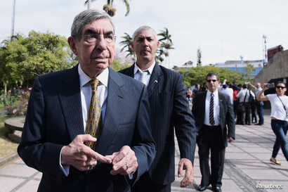 Costa Rica's former president Oscar Arias, walks after presenting his statement regarding complaints against him over sexual assault at the Attorney's Office, in San Jose, Costa Rica, Feb. 13, 2019.