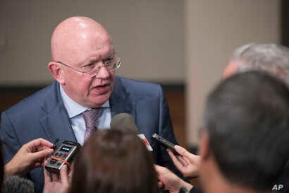 Russia's U.N. Ambassador Vassily Nebenzia speaks to reporters after attending a Security Council meeting, Aug. 9, 2017, at United Nations headquarters.