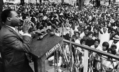 The Rev. Martin Luther King Jr. addresses a crowd of some 3,000 persons, April 30, 1966, in Kelly Ingram Park on the last day of his three-day whistle-stop tour of Alabama, encouraging black voters to vote as a bloc in the primary election.