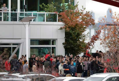 Google employees gather in a courtyard as they take part in a walkout from their jobs at the Google campus in Kirkland, Washington, Nov. 1, 2018.