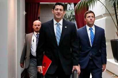 House Speaker Paul Ryan of Wisconsin, center, arrives for a meeting with House Republicans, Sept. 6, 2017, on Capitol Hill in Washington.