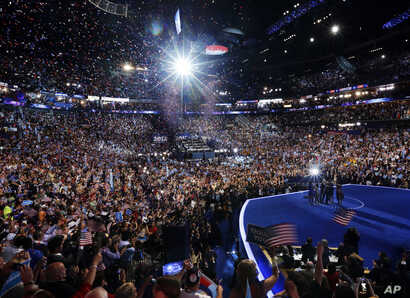 President Barack Obama, first lady Michelle Obama, their children Malia and Sasha, and Vice President Joe Biden and his wife Jill Biden, wave on stage on the final day of the Democratic National Convention in Charlotte, N.C., Thursday, Sept. 6, 2012