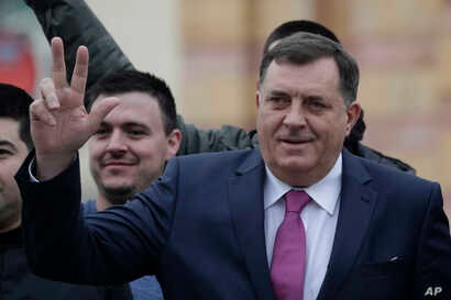 Milorad Dodik, President of the Republika Srpska gestures moments before a parade marking 26th anniversary of the republic in the Bosnian town of Banja Luka, Jan. 9, 2018.