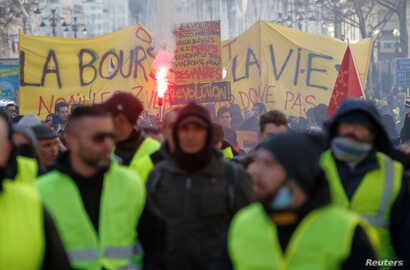 """FILE - Protesters wearing yellow vests take part in a demonstration of the """"yellow vests"""" movement in Marseille, France, Jan. 26, 2019."""