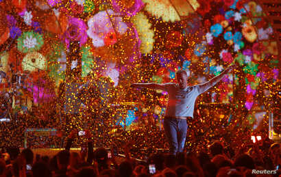 FILE - Coldplay lead singer Chris Martin performs during the iHeartRadio Music Festival at T-Mobile Arena in Las Vegas, Nevada, Sept. 22, 2017.