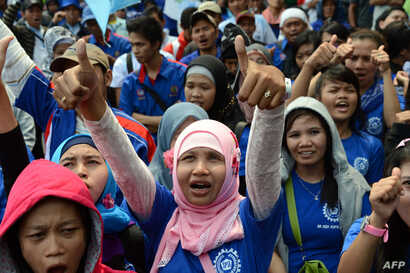 Indonesian workers from various labour groups attend a rally against outsourcing to contract workers in Jakarta on October 3, 2012. Thousands of workers took part in the demonstration to demand better welfare and working conditions, as well as higher...