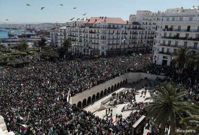 People gather during a protest over President Abdelaziz Bouteflika's decision to postpone elections and extend his fourth term in office, in Algiers, Algeria March 15, 2019.