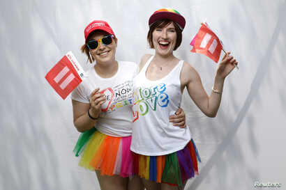 Katrina, 25, left, and Devon, 22, pose for a portrait during the Resist March against President Donald Trump in West Hollywood, California, June 11, 2017.