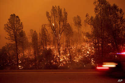 The Carr Fire burns along Highway 299 in Shasta, Calif., July 26, 2018.