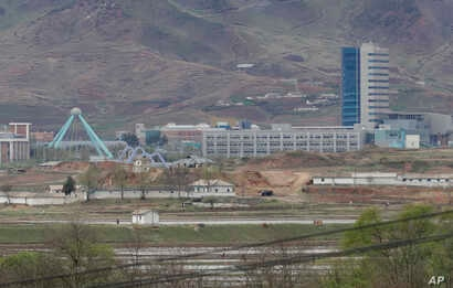 FILE - The Kaesong industrial complex in North Korea is seen from inside the demilitarized zone during a press tour in Paju, South Korea, April 24, 2018. South Korean President Moon Jae-in and North Korean leader Kim Jong Un met at the southern side ...