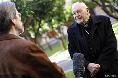 FILE - Cardinal Theodore McCarrick speaks during an interview at the North American College at the Vatican, Feb. 14, 2013.