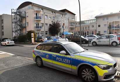 Police stand in front of a senior home in Ahlen, Germany, where Jakiw Palij, an accused former Nazi guard, arrived Aug. 21, 2018.