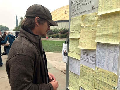 Wildfire evacuee Greg Gibson looks for information about his missing neighbors at The Neighborhood Church in Chico, Calif., Nov. 13, 2018.
