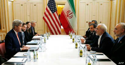 """US Secretary of State John Kerry (L)  meets with Iranian Foreign Minister Javad Zarif (2R) in Vienna, Austria on Jan. 16, 2016, on what is expected to be """"implementation day,""""  the day the IAEA verifies that Iran has met all conditions under the nucl..."""