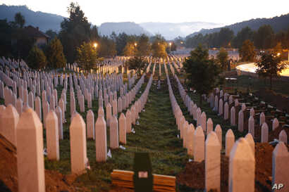 Srebrenica Massacre: Gravestones are seen at sunrise at a memorial complex near Srebrenica, 150 kilometers (94 miles) northeast of Sarajevo, Bosnia and Herzegovina, Saturday, July 11, 2015. Twenty years ago, on July 11, 1995, Serb troops overran the
