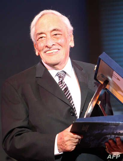 FILE - Egyptian actor Gamil Ratib holds his honorary award during the opening ceremony of the Alexandria Film Festival for Mediterranean Countries in the Egyptian port city of Alexandria, late on September 14, 2010.
