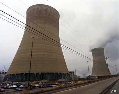 FILE - Cooling towers are seen at the Beaver Valley Power Station in Shippingport, Pennsylvania, Dec. 11, 2000.