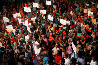 Opposition supporters protest against the government's delay in releasing their jailed leaders, including former president Mohamed Nasheed, despite a Supreme Court order, in Male, Maldives, Feb. 4, 2018.