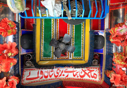Speakers and a fan are seen in the cab of a decorated truck in Faisalabad, Pakistan, May 4, 2017.