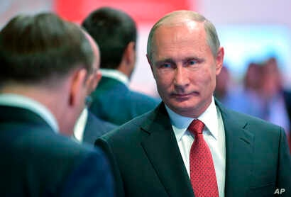 Russian President Vladimir Putin, right, attends a meeting with students in Yaroslavl, Russia, Sept. 1, 2017.