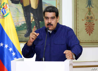 Handout picture released by the Venezuelan presidency showing Venezuelan President Nicolas Maduro speaking during a press conference at the Miraflores Presidential Palace in Caracas, Venezuela, March 11, 2019.