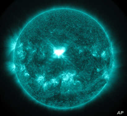 This image provided by NASA, shows an extreme ultra-violet wavelength image of solar flare captured about 1:45 p.m. EDT, Sept. 10, 2014.