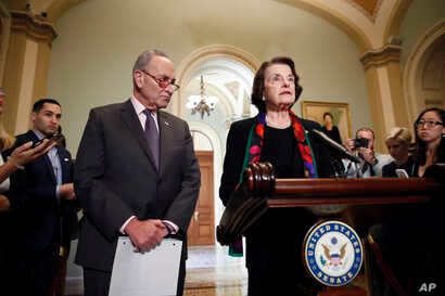 Senate Judiciary Committee Ranking Member Sen. Dianne Feinstein, D-Calif., speaks to the media, accompanied by Senate Minority Leader Chuck Schumer, D-N.Y., about the FBI report on sexual misconduct allegations against Supreme Court nominee Brett Kav...