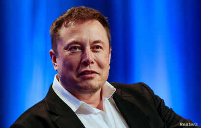 """FILE - Tesla and SpaceX CEO Elon Musk participates in a """"fireside chat"""" at the National League of Cities (NLC) 2018 City Summit in Los Angeles, California, Nov. 8, 2018."""