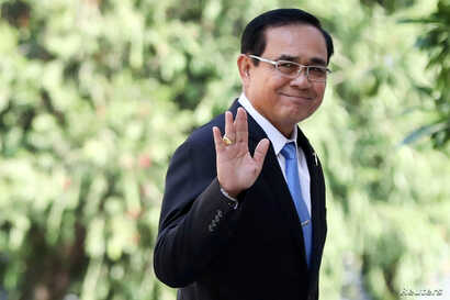 FILE - Thailand's Prime Minister Prayuth Chan-ocha gestures as he leaves after a meeting at Government House in Bangkok, Thailand, Jan. 24, 2019.