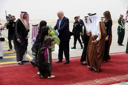 President Donald Trump and first lady Melania Trump are greeted by King Salman shortly after arriving at the Royal Terminal of King Khalid International Airport, May 20, 2017, in Riyadh.