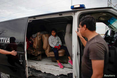 A child leaves a temporary shelter for migrants in a police car, in Piedras Negras, Mexico, Feb. 7, 2019.