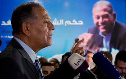 FILE - Mohammed Anwar Sadat, nephew of Egypt's late leader Anwar Sadat and the leader of Reform and Development Party, speaks during a press conference at the party headquarters, in Cairo, Egypt, Jan. 15, 2018. Egyptian President Abdel-Fattah el-Siss...