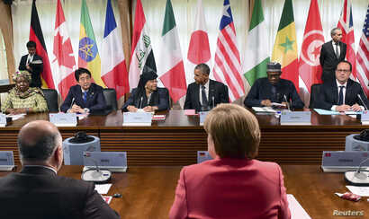FILE - Participants attend the second working session of the G7 summit in Kruen, Germany, June 8, 2015, where leaders vowed to keep sanctions against Russia in place.