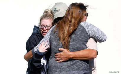 Mourners react outside a reception center for families of victims of a mass shooting in Thousand Oaks, Calif., Nov. 8, 2018.