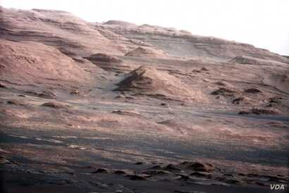 This photo, taken by the Curiosity rover, shows the layered geology of Mars.