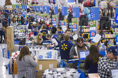 Customers wrap up their holiday shopping during Walmart's Black Friday events  in Bentonville, Ark., Thursday, Nov. 27, 2014.