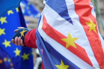 An anti-Brexit demonstrator wears a combination of EU and Union flags outside the Houses of Parliament in London, Britain, No. 26, 2018.