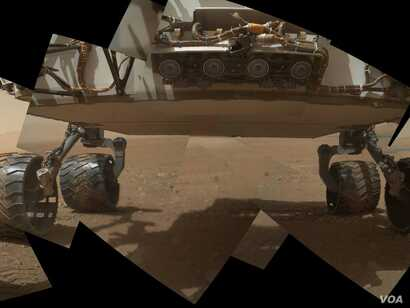 This view of the lower front and underbelly of Curiosity combines nine images taken on September 9, 2012.