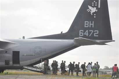 U.S marines disembark upon their arrival at the Roberts International airport in Monrovia, Liberia, Thursday, Oct. 9, 2014. Six U.S. military planes arrived Thursday at the epicenter of the Ebola crisis, carrying more aid and American Marines into Li...