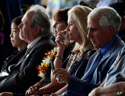 Robert Sanfilkippo, right, sits next to his wife, Diana Brown Sanfilippo who has spent a lifetime searching for her father, 1st Lt. Frank Salazar who died 66 years ago in North Korea. She wipes her eyes as she sits with Karen Pence, wife of Vice Pres...