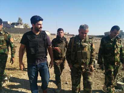 Peshmerga soldiers say they cleared this and other villages of Islamic State militants in about six hours, and several of their bodies remain in the now abandoned village in Khadir province, Kurdistan northern Iraq, 29 October 2016. (VOA/H, Murdock) ...