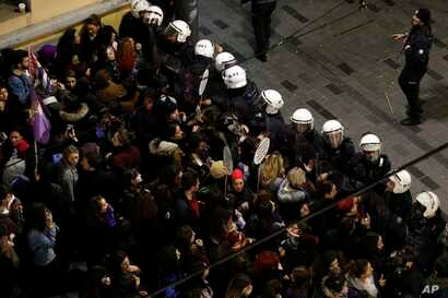 Turkish police block protesters wanting to hold a march for the International Women's Day, in Istanbul, March 8, 2019.