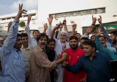 Supporters of Pakistan Tahreek-e-Insaf party headed by Imran Khan, celebrate the success of their leader outside the National Assembly in Islamabad, Pakistan, Aug. 17, 2018.