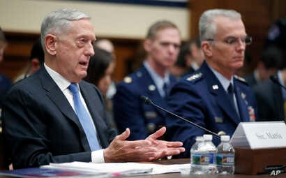 Defense Secretary Jim Mattis, left, accompanied by Joint Chiefs Vice Chairman General Paul J. Selva, speaks during a hearing of the House Armed Services Committee on Capitol Hill, Feb. 6, 2018, in Washington.