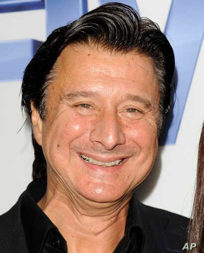 FILE - In this Sept. 26, 2011 file photo, Steve Perry, former lead singer of the rock band Journey, arrives at  a premiere screening at Skylight SoHo in New York.