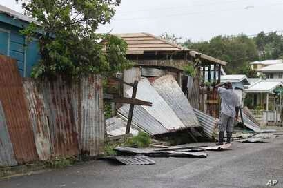 A man surveys the wreckage on his property after the passing of Hurricane Irma, in St. John's, Antigua and Barbuda, Sept. 6, 2017.