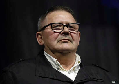 Jozef Kuciak, father of the murdered journalist Jan Kuciak attends during a rally to mark one year anniversary of the slayings of his son and his fiancee, in Bratislava, Slovakia, Feb. 21, 2019.