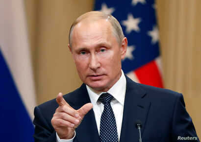 Russian President Vladimir Putin gestures during a joint news conference with U.S. President Donald Trump (not pictured) after their meeting in Helsinki, Finland July 16, 2018.